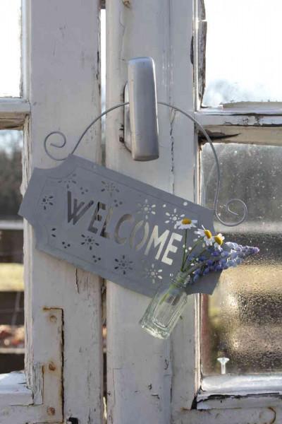 Welcome-Schild mit kleiner Flasche
